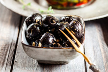 Bowl Of Black Olives With Garlic
