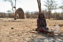Himba Woman Sitting On Sandy S...