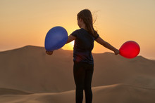 Girl Playing With Balloons In ...