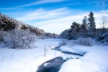 Stream Running Through A Snow ...