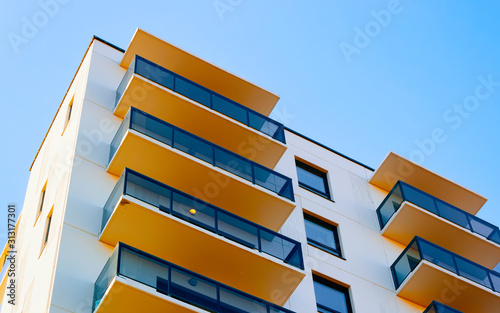 Obraz Apartment in residential building exterior. Housing structure at blue modern house of Europe. Rental home in city district on summer. Architecture for business property investment, Vilnius, Lithuania. - fototapety do salonu