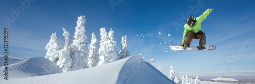 Photo A Snowboarder Jumping
