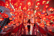 Leinwanddruck Bild - Woman walking and enjoying traditional red lanterns decorated for Chinese new year Chunjie. Asian culture inspiration. Trend lava color.