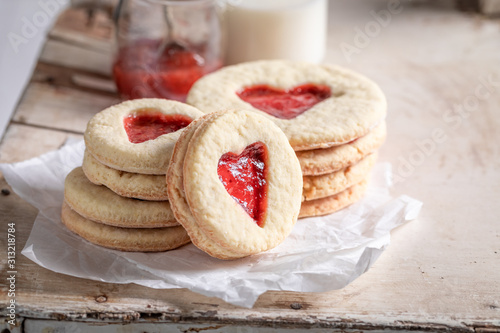 Tasty biscuits for valentine with red strawberries jam Wallpaper Mural