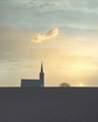 canvas print picture - Church chapel silhouette building and tree with large sky place of religious worship during sunset at St Cyrus Angus Scotland UK