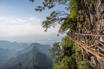 Fototapeta Góry Tianmen Mountain Known as The Heaven`s Gate surrounded by the green forest and mist at Zhangjiagie, Hunan Province, China, Asia.