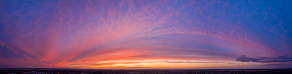 Aerial View Of Sunset Sky Background Backdrop. Top View From High Attitude In Autumn Sunrise. Amazing Natural Bright Dramatic Sky In Different Colours. Colorful Sky Background. Beauty In Nature