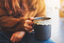 Closeup Image Of A Woman Holding A Cup Of Hot Coffee