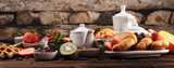 Fototapeta Kawa jest smaczna - Breakfast served with coffee, orange juice, croissants, cereals and fruits. Balanced diet. Continental breakfast with granola and fruits