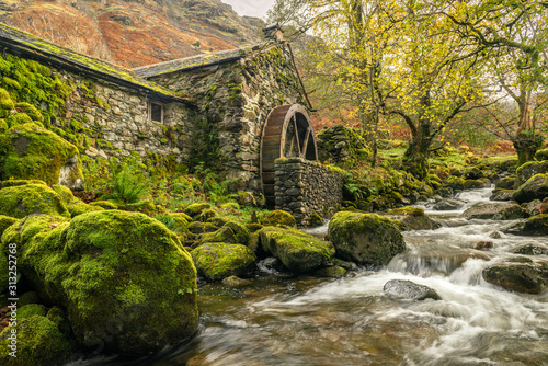 Obraz na płótnie Old mill with a waterwheel built in the early 1800's in Borrowdale in the Lake D