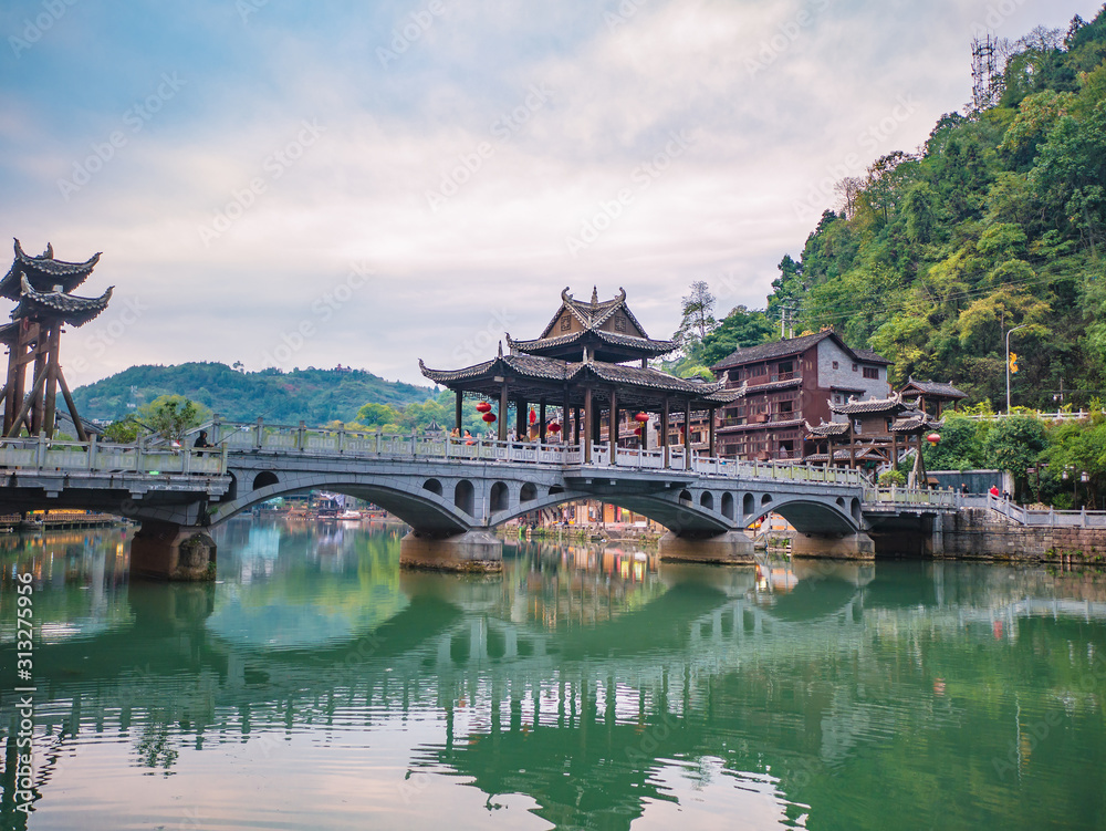 Fototapeta fenghuang,Hunan/China-16 October 2018:Tourist on Fenghuang old town bridge with Scenery view of fenghuang old town .phoenix ancient town or Fenghuang County is a county of Hunan Province, China