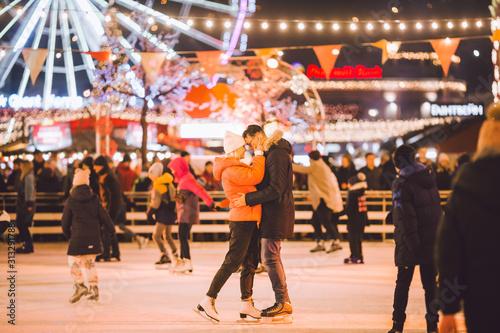 Fényképezés  Beautiful couple have fun in ice arena