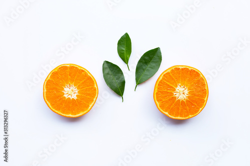 Fresh orange citrus fruits with leaves on white background.
