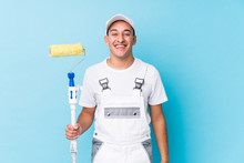 Young Professional Painter Latin Man Isolated Laughing And Having Fun.