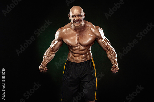 Bodybuilding competitions on the scene. Handsome and fit man sportsmen bodybu...