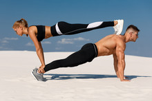 Sporty Fitness Couple Doing Pl...