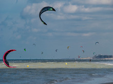 Huge Kite Surfing Activity At The Beach