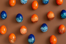 Beautiful Easter Background With Orange And Blue Decorative Eggs.