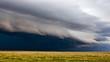 Leinwandbild Motiv Storm clouds over a field