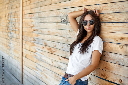 Outdoor street fashion portrait of stylish woman in sunglasses