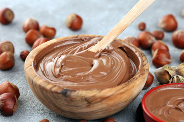 Homemade hazelnut spread in wooden bowl. Hazelnut Nougat cream with hazelnuts