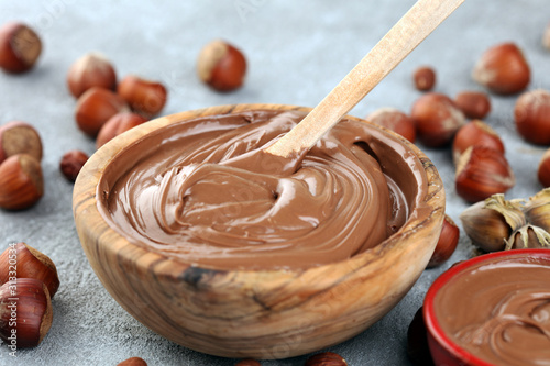 Obraz Homemade hazelnut spread in wooden bowl. Hazelnut Nougat cream with hazelnuts - fototapety do salonu