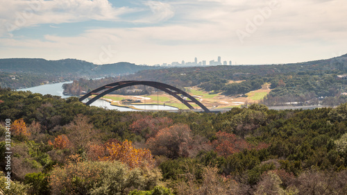Photo View of of Metal Bridge outside of Austin Texas, with Skyline in the Background