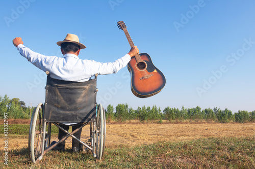 Young disabled man and field background Tablou Canvas