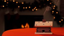 Smoke Curls From The Chimney Of An Incense Smoker In The Shape Of A Tiny Log Cabin. Using Incense Cones Is A German Christmas Tradition.
