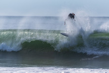 Surfer Is Upside Down And Falling After Wiping Out On Large Wave Ride In California.