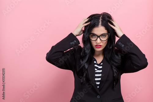 Fotografie, Tablou  Young woman feeling stressed on a pink background