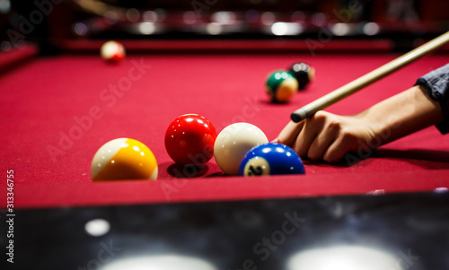Foto Boy plays billiard or pool in club