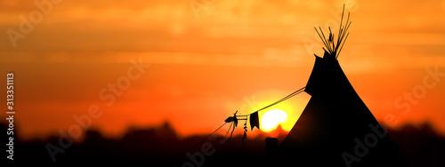 Obraz na plátně An American Indian tipi (teepee) against an evening sunset.
