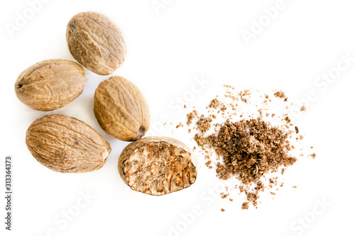 Fototapeta Nutmeg Whole and Ground Top View Isolated obraz