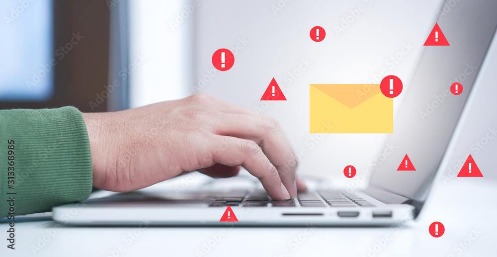 Fototapeta close up programmer man hand typing on laptop keyboard to protect spam mail from  internet cyber concept