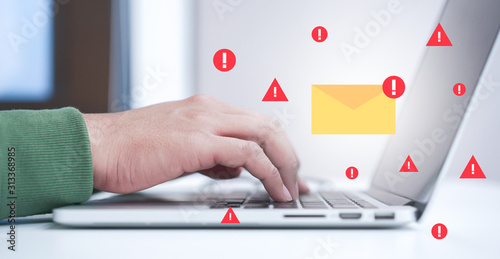 Obraz close up programmer man hand typing on laptop keyboard to protect spam mail from  internet cyber concept - fototapety do salonu