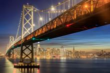 Western Span Of San Francisco-Oakland Bay Bridge And San Francisco Waterfront In Blue Hour. Shot From Yerba Buena Island, San Francisco, California, USA.