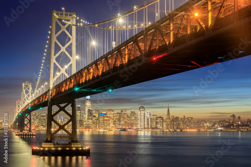 Photo Western Span of San Francisco-Oakland Bay Bridge and San Francisco Waterfront in Blue Hour