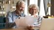 Leinwanddruck Bild - Senior couple use online banking on laptop planning family budget