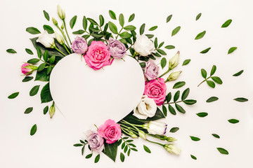 Naklejka Boho Valentine's day romantic concept. Creative floral heart made of white and pink roses and green leaves