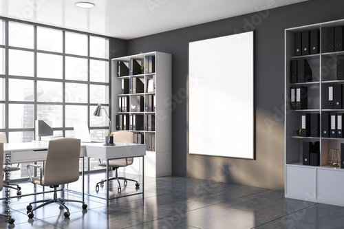 Gray CEO office corner with bookcase and poster