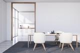 Fototapeta Kawa jest smaczna - White dining room with armchairs and kitchen