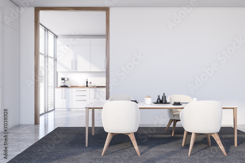 plakat White dining room with armchairs and kitchen