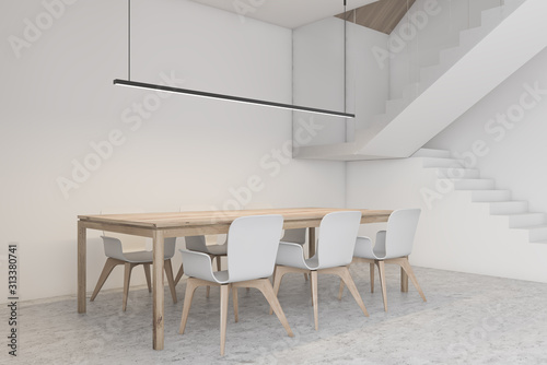 Obraz White dining room corner with stairs - fototapety do salonu