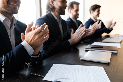 Close up of businessmen applaud at business company meeting Canvas Print