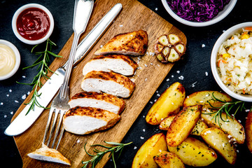Barbecue chicken fillet with baked potatoes and vegetables