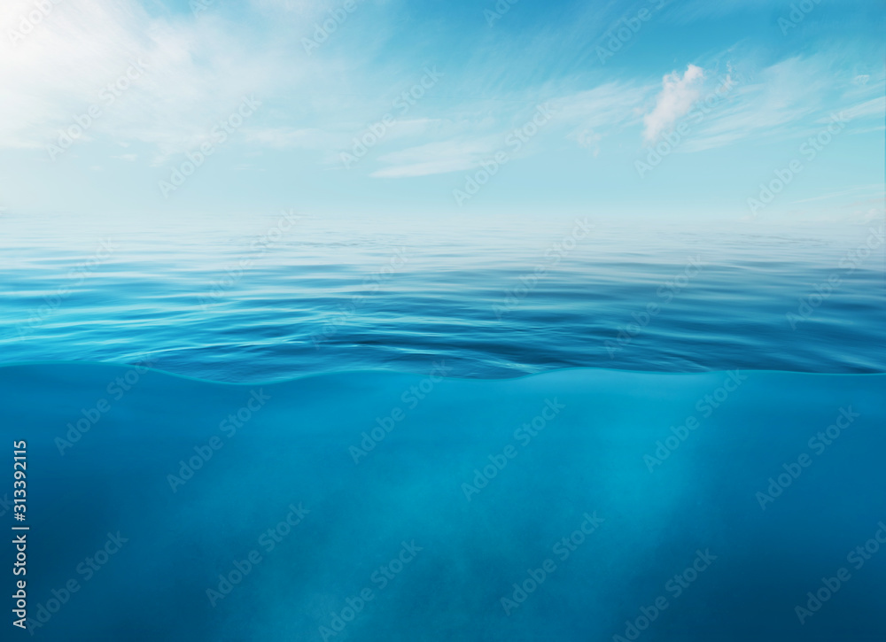Fototapeta Blue sea or ocean water surface and underwater with sunny and cloudy sky
