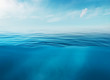 canvas print picture - Blue sea or ocean water surface and underwater with sunny and cloudy sky