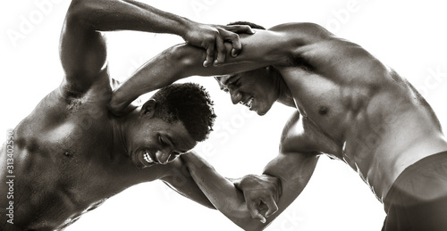 Strong male black athletes wrestling. Strength competition. Fototapet