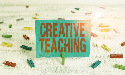 Word writing text Creative Teaching. Business photo showcasing making something fine out of learning situations Green clothespin white wood background colored paper reminder office supply